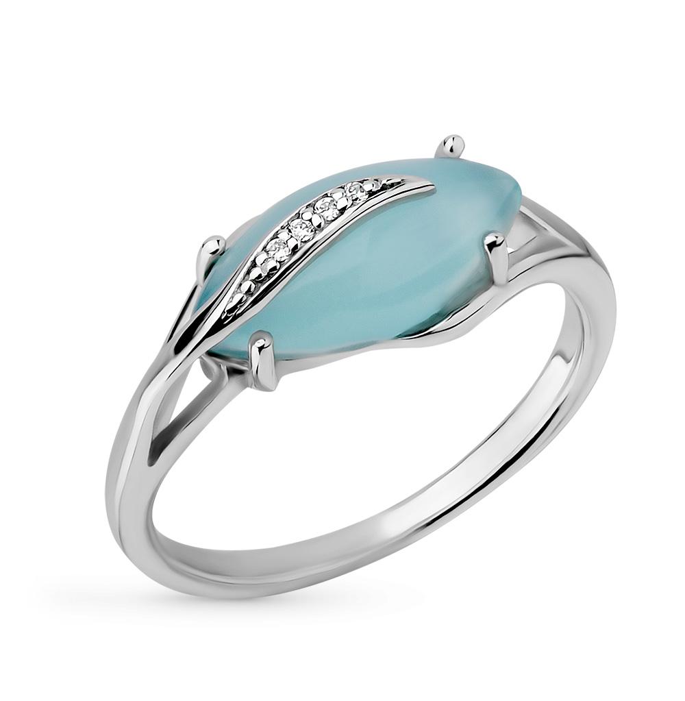 Фото «серебряное кольцо с фианитами, кошачьими глазами имитациями и лунными камнями»